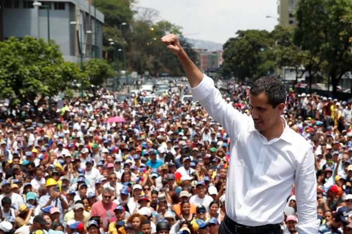 Venezuelan opposition leader Juan Guaido, who many nations have recognised as the country's rightful interim ruler, gestures as he speaks to supporters during a rally against the government of Venezuela's President Nicolas Maduro and to commemorate May Day in Caracas Venezuela, May 1, 2019.