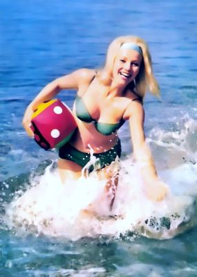 Vintage Bikini style, color and fashion in 1970s. Retro beach costume and hair style in Panton Eames era
