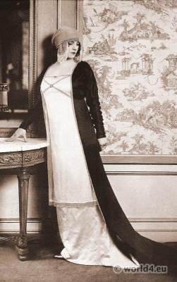 Paul Poiret - Paris 1912. Evening toilet. Tunic of black satin, petticoat of white satin. Art-nouveau fashion.