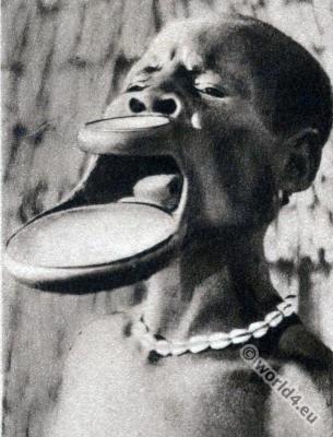 Traditional Africa tribals piercing. African Sara women lip plate.