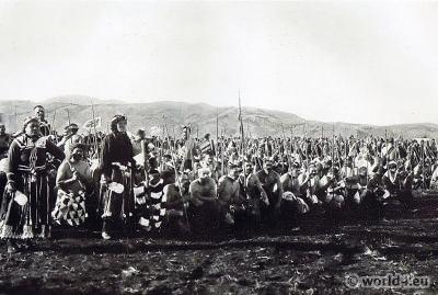Māori warriors wearing piu-pius of flax, performing the Poi dance