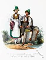 Tyrolean national costumes. Austrian traditional fashion. Achen folk dress.
