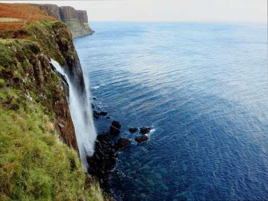 Kilt Rock waterfall directly into the sea Island Skye Scotland