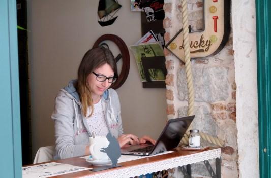 Editing pictures at Corto Maltese Freestylefood café in Split Croatia