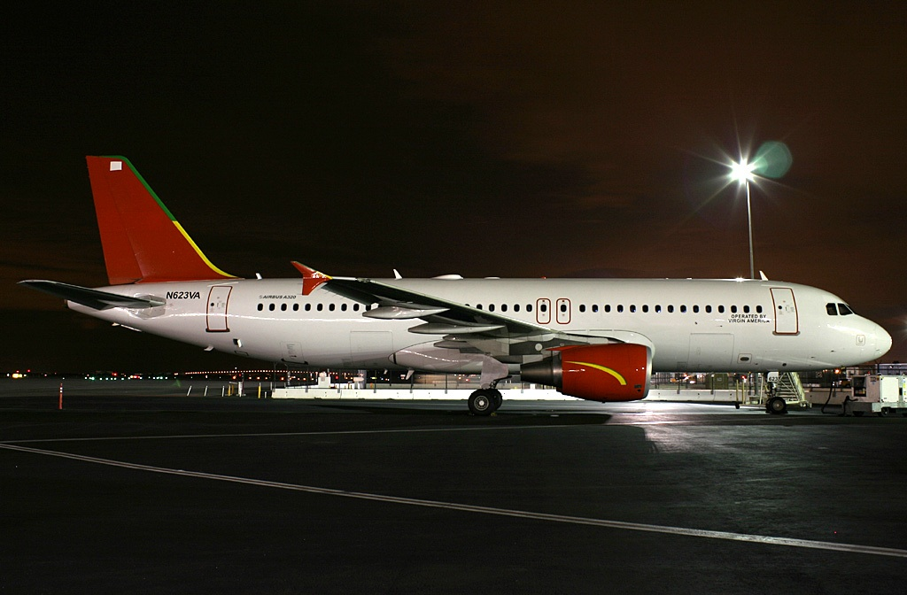 N623VA rests overnight at the gate at the San Francisco base.  Copyright Photo: Mark Durbin.