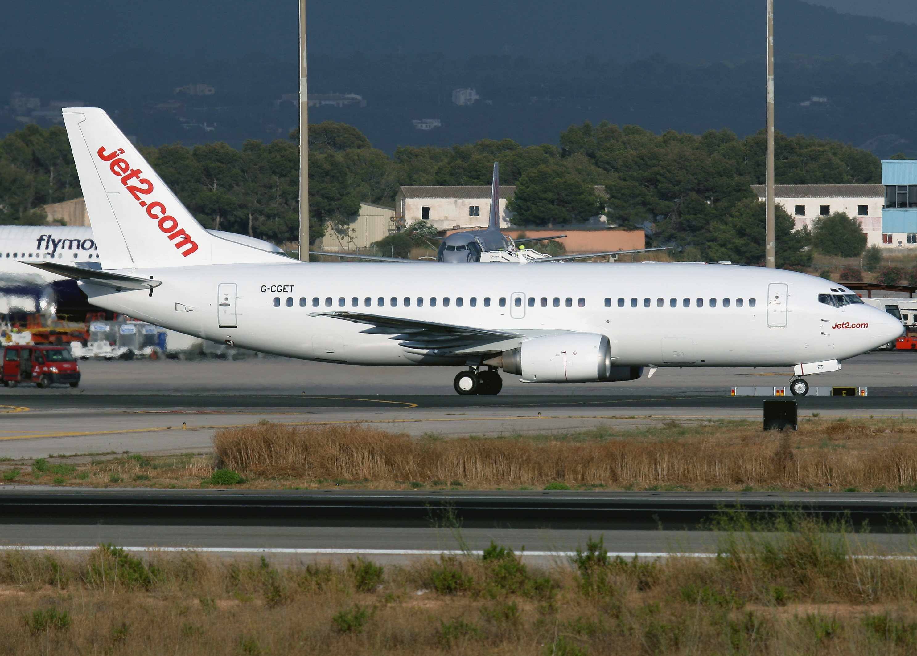 G-CGET is pictured on the ground at Palma de Mallorca in a basic all-white condition.  Copyright Photo: Javier Rodriguez.