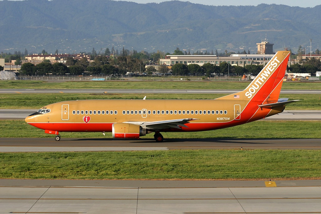 N387SW taxies at San Francisco before it was repainted in the new colors.  N387SW is relatively new and was originally delivered to WN on June 29, 1994.  Copyright Photo: Mark Durbin.
