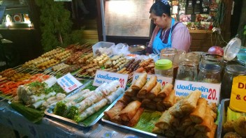 Fried wrapped things, meat on a stick -- staples of Thai street food.