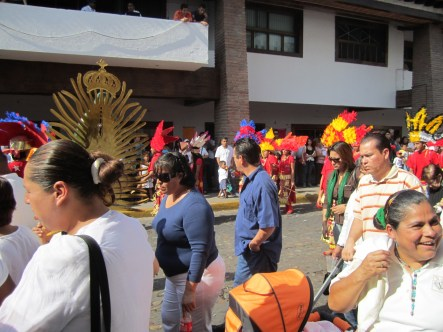 People celebrate the Festival of the Lady of Guadalupe with a parade.