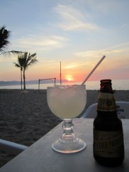 A giant margarita and a beer on the beach at sunset... what could be better?