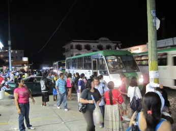 A gas station serves as a popular stop for buses downtown.