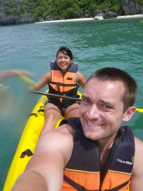 Heading out on our sea kayak, with the beach behind us.