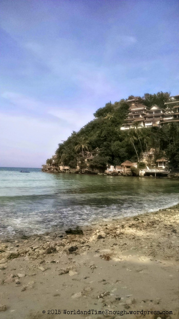 The resort at Diniwid Beach, as well as the rocky shore. The water gets much clearer a little further out.