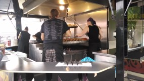 So many sausages in the making. German street food events are great!