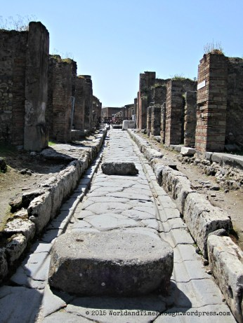 A typical street. The ruts are from carriages, and the stone blocks are for crossing in case of a flood or wet streets.