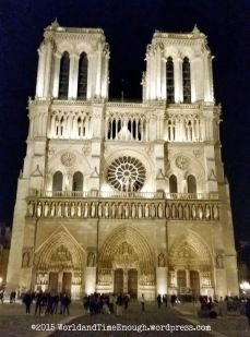 Notre Dame facade lit up at night