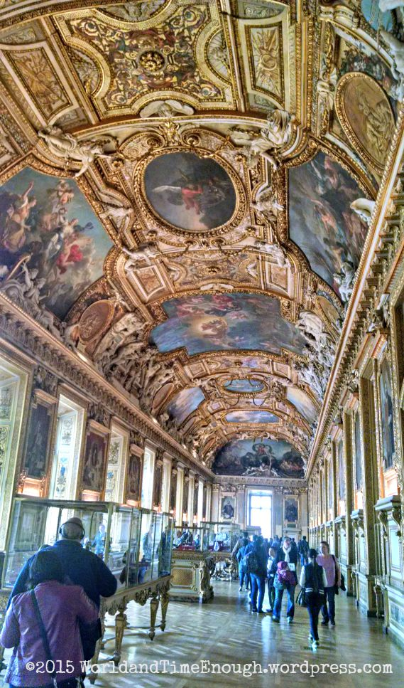 In the Louvre, even the walls and ceilings are art.