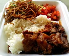 Sweet and sour spareribs, lomi-lomi salmon, and fried noodles from Pono Market in Kapaa.