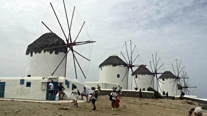 Still windmills on a cloudy day