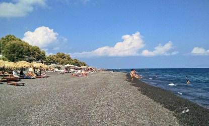 Kamari, a black pebble beach