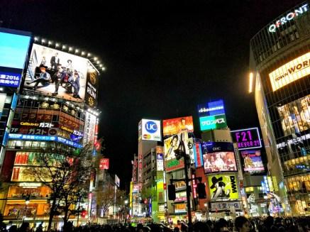 Neon lights brighten the night at Shibuya.