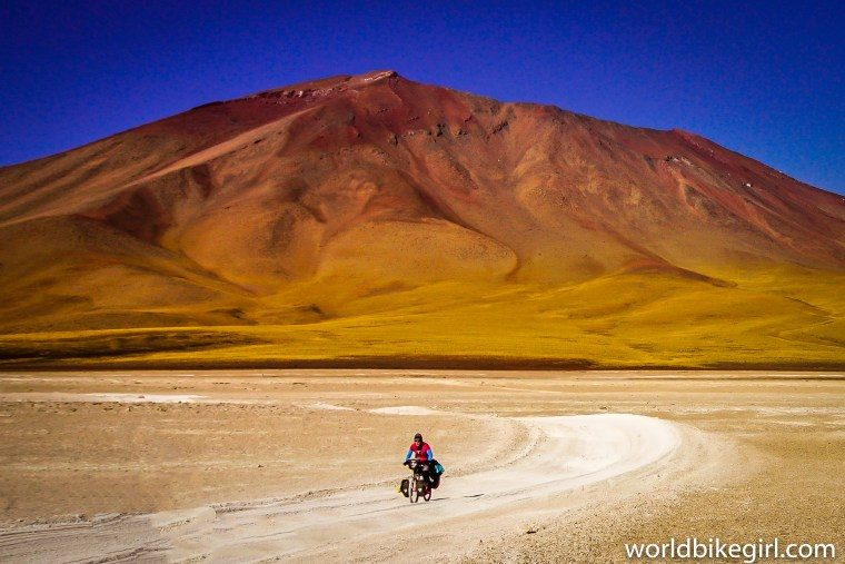 Photo of myself cycling the Kibo Bicycle across the Andes in Bolivia