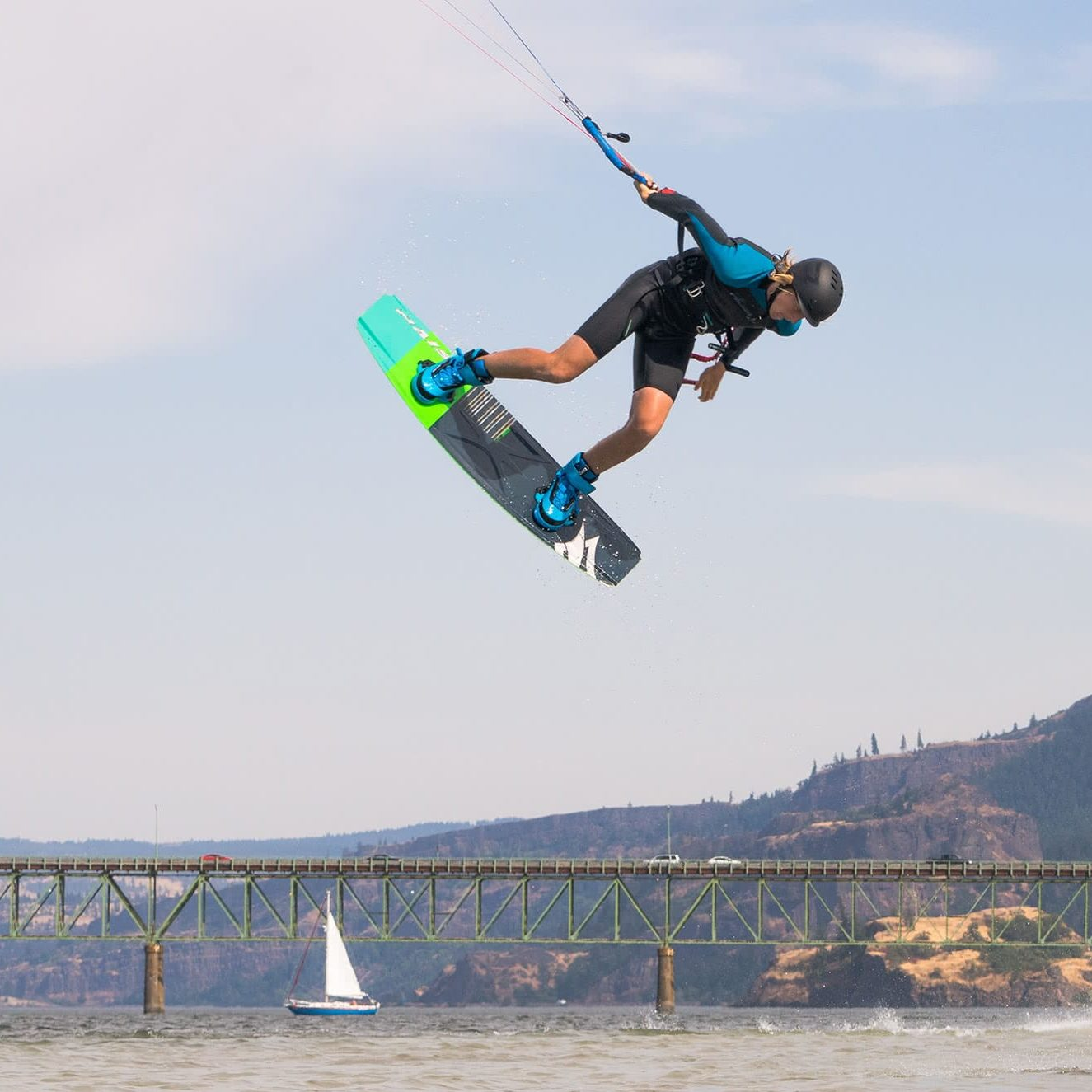 Young Kiteboarder doing a grab at the Hood River Junior Jam