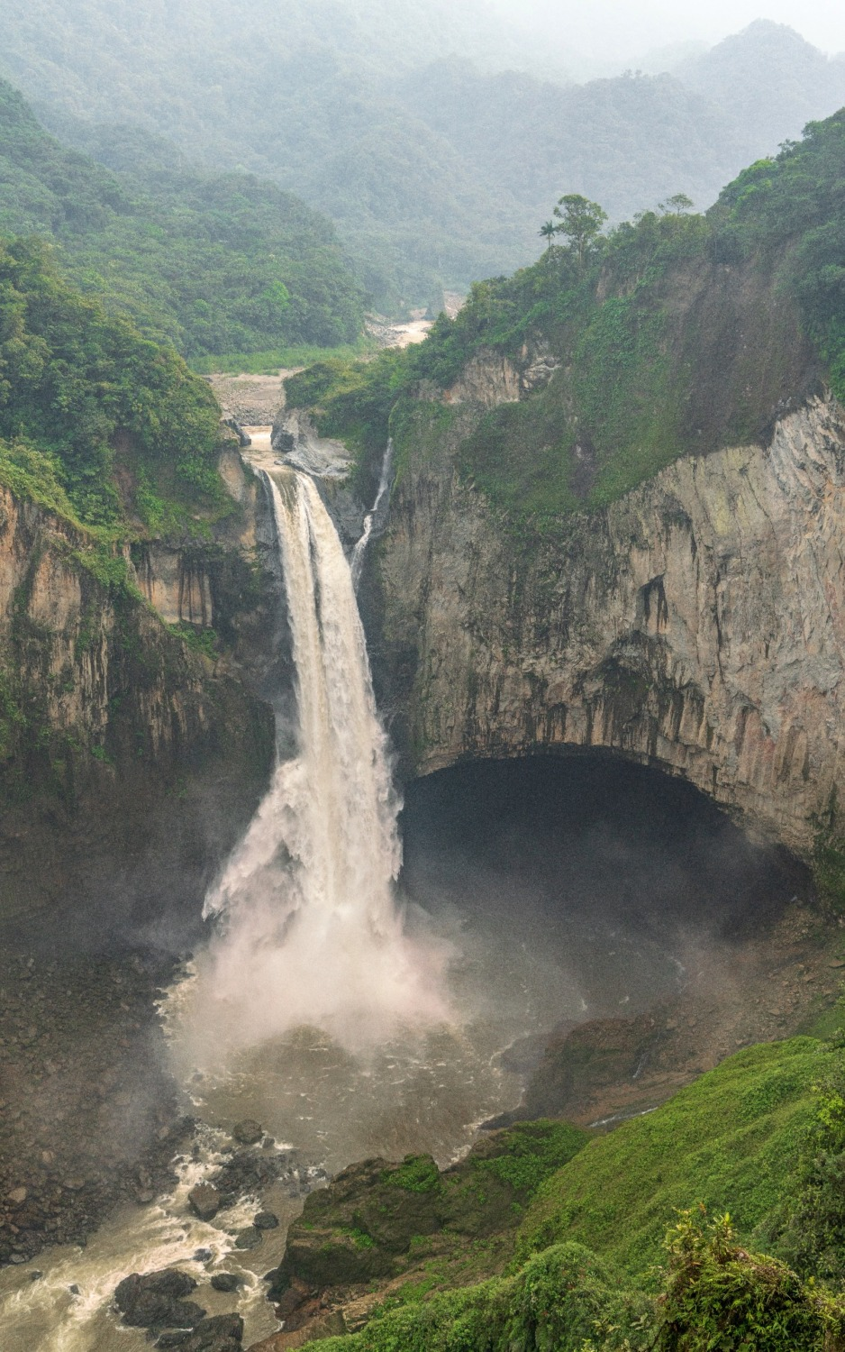 San Rafael falls centers the image as thew Quijos river plunges 500ft to the pool below.