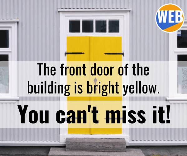 The front door of the building is bright yellow. You can't miss it!