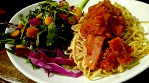 Wholewheat pasta with harissa bacon relish and an asian gooseberry salad