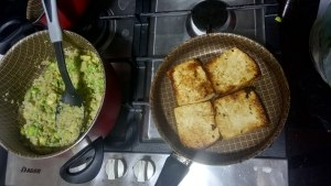 Avo and fava bean quinotto with tofu steaks and a tomato anatto reduction