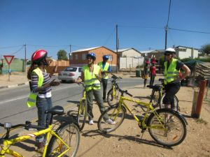 Tour guide Anna prepares group for bike tour through Katutura, Namibia. Photo: Chris Chesak