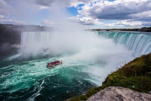 Aerial view of Niagara Falls with a Maiden of the Mist boat.
