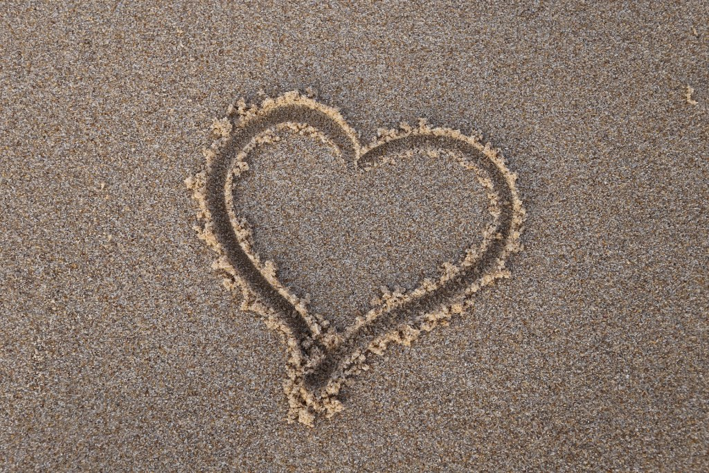 A heart in the sand for loving traveling couples