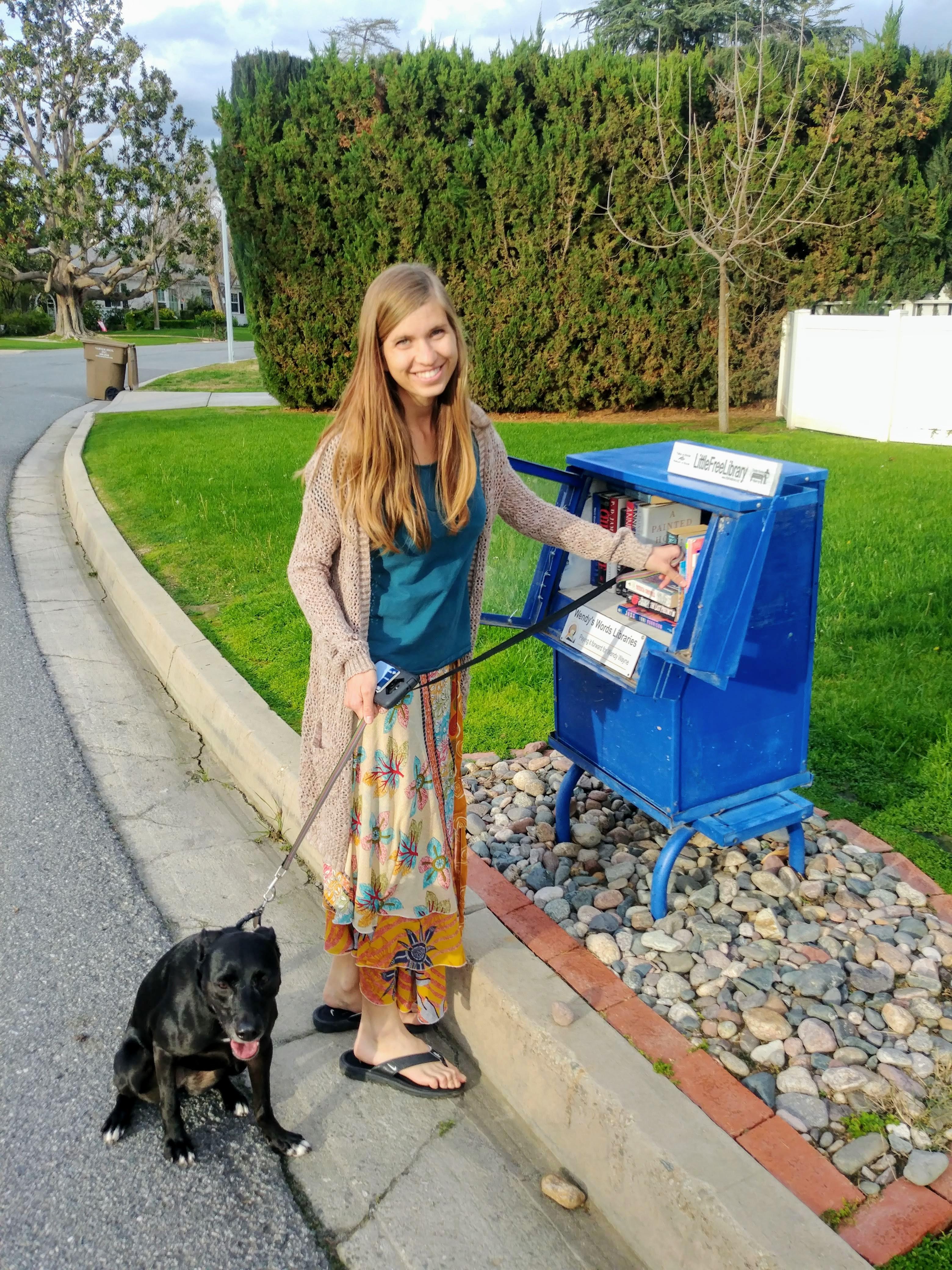 Author Breana Johnson with her puppy at a free library box. Photo: Breana Johnson