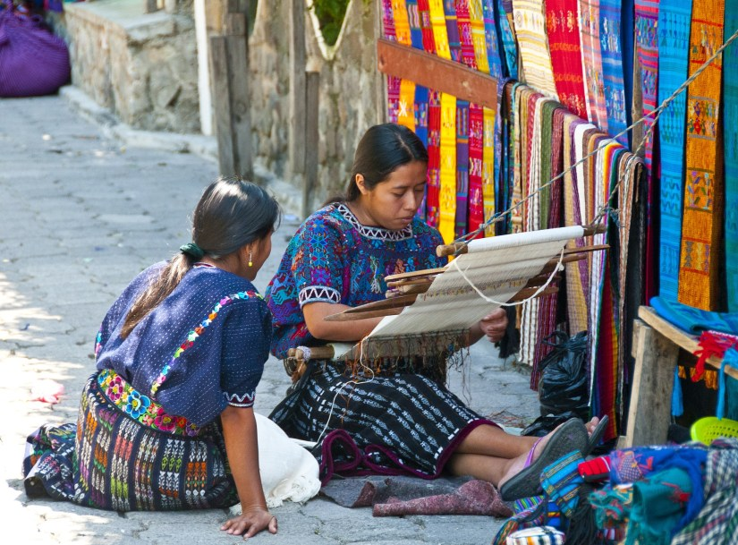 Mayan women enjoying their craft of weaving.