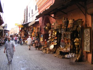 The narrow alley in the Souk des Ferronniers, in the Marrakech medina is lined with lamps and other crafts.