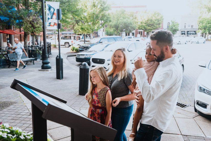 Visitors viewing markers explaining the Fuller Story and explain the tragic events that took place in in Franklin, Tennessee's downtown public square. (Photo courtesy Visit Franklin)