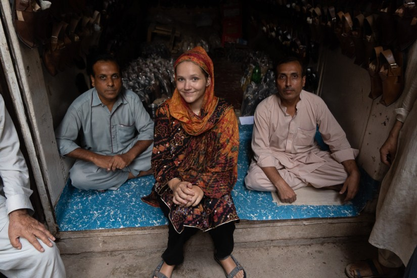 Author with some friendly shoemakers who invited her for tea in peshawar. Photo: Samantha Shea
