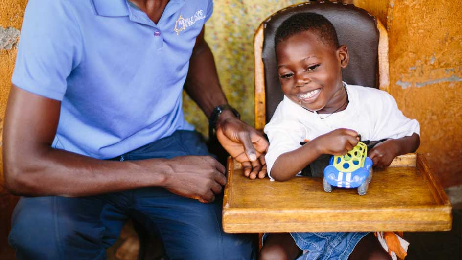 Young boy receiving therapy while in his highchair
