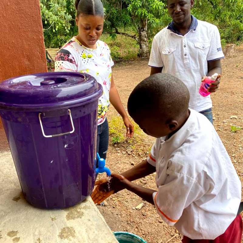 Girl holding soap and handwashing instructions