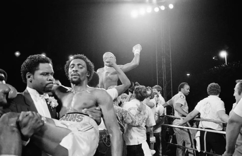 Thomas Hearns Is Carried Away As Marvin Hagler Celebrates Victory