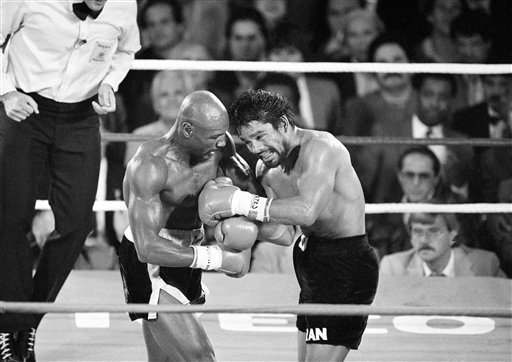 &Quot;Marvelous&Quot; Marvin Hagler, Connects With A Blow To Roberto Duran, Right,