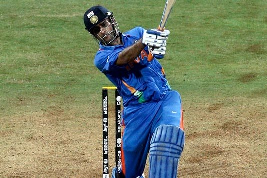 Dhoni captain of India hits the winning runs watched by Kumar Sangakkara captain of Sri Lanka to secure victory during the  ICC World Cup