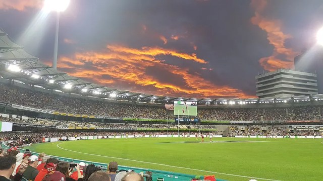 The Eastern end of The Gabba at sunset during an AFL game
