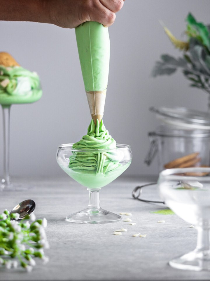 Piping soft serve matcha icecream to serving cup