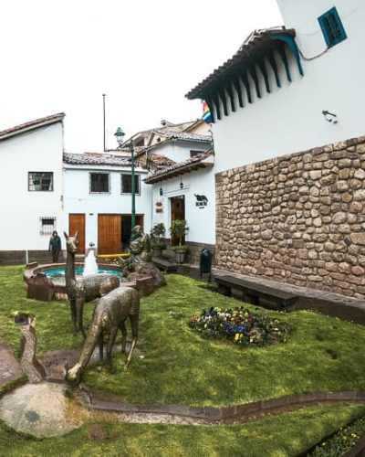 alpaca statues inside of downtown cusco