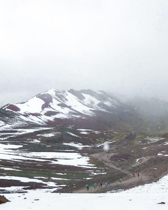 rainbow mountain hike in the snow