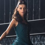 image of female character from westworld, brunette in green dress