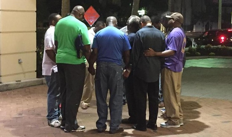 Local pastors gathered outside the Courtyard Marriott down the street from the church. Photo credit Liz Kreutz via Twitter.